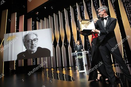 Cinematographer Fabrice Aragno, right, the special Palme d'Or award on behalf of director Jean-Luc Godard, on screen, for his film 'The Image Book' during the closing ceremony of the 71st international film festival, Cannes, southern France