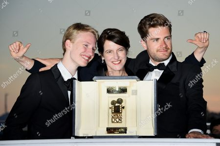 Lukas Dhont (R) poses with Ursula Meier and Victor Polster during the Award Winners photocall after he won the Camera d'Or Prize for 'Girl' at the 71st annual Cannes Film Festival in Cannes, France, 19 May 2018.
