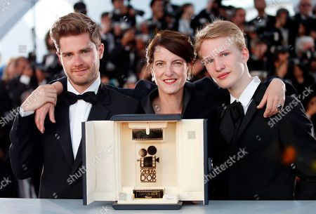 Lukas Dhont (L) poses with Ursula Meier and Victor Polster during the Award Winners photocall after he won the Camera d'Or Prize for 'Girl' at the 71st annual Cannes Film Festival in Cannes, France, 19 May 2018.