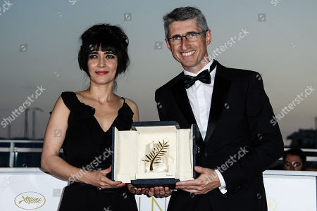 Cinematographer Fabrice Aragno (R) poses with the Special Palme d'Or award on behalf of director Jean-Luc Godard for his film 'The Image Book' (Le Livre D'Image) at the 71st annual Cannes Film Festival in Cannes, France, 19 May 2018.