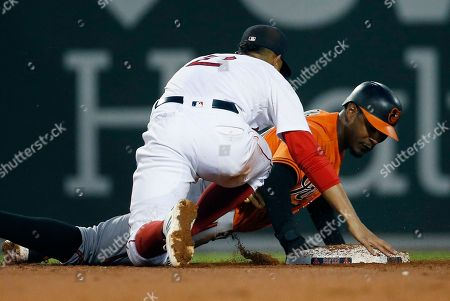 Stock Picture of Adam Jones, Xander Bogaerts. Baltimore Orioles' Adam Jones slides safely back to second base in front of Boston Red Sox's Xander Bogaerts (2) after a pickoff attempt during the third inning of a baseball game in Boston