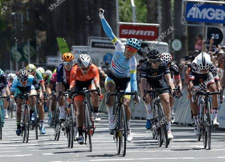 Arlenis Sierra raises her fist in celebrate as she crosses the finish line to win the third stage of the Amgen Tour of California Women's cycling race, in Sacramento, Calif. Katie Hall won the overall three-day race