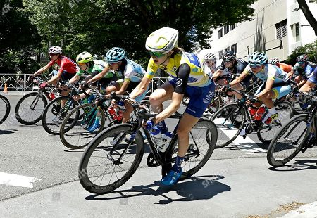 Stock Image of Katie Hall rounds a corner during the final stage of the Amgen Tour of California Women's cycling race, in Sacramento, Calif. Hall won the overall three-day race