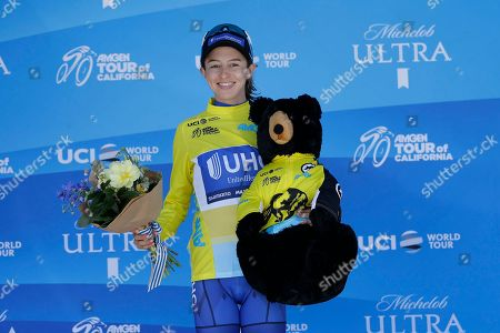 Katie Hall smiles after winning the Amgen Tour of California Women's cycling race, in Sacramento, Calif