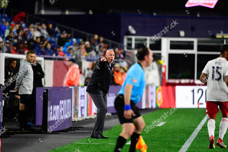 New England Revolution head coach Brad Friedel directs the team from the sideline during the MLS game between Columbus Crew and the New England Revolution held at Gillette Stadium in Foxborough Massachusetts. Columbus defeats New England 1-0