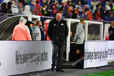 New England Revolution head coach Brad Friedel paces on the sideline during the MLS game between Columbus Crew and the New England Revolution held at Gillette Stadium in Foxborough Massachusetts. Columbus defeats New England 1-0