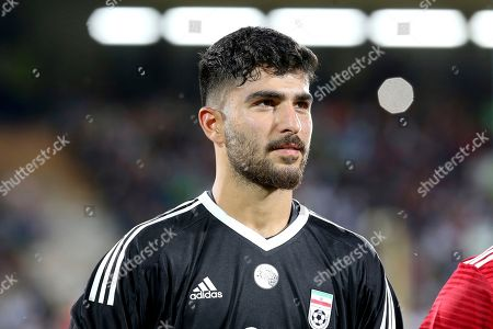 Iran's goalkeeper Amir Abedzadeh listens to the national anthem before the international friendly soccer match between Iran and Uzbekistan at the Azadi Stadium in Tehran, Iran