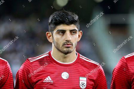 Iran's Mehdi Torabi listens to the national anthem before the international friendly soccer match between Iran and Uzbekistan at the Azadi Stadium in Tehran, Iran