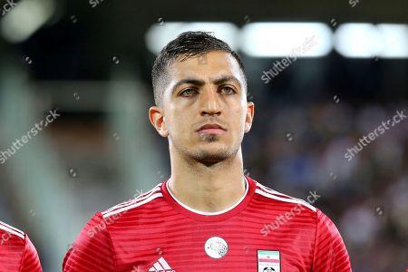 Iran's Seyed Majid Hosseini listens to the national anthem before the international friendly soccer match between Iran and Uzbekistan at the Azadi Stadium in Tehran, Iran