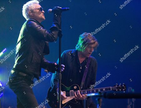 Jeff Gutt, Dean DeLeo. Jeff Gutt, left, and Dean DeLeo of the band Stone Temple Pilots perform in concert during the MMRBQ at the BB&T Pavilion, in Camden, N.J