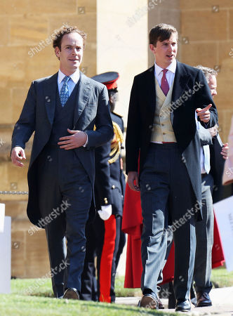Tom Inskip, left, arrives for the wedding ceremony of Prince Harry and Meghan Markle at St. George's Chapel in Windsor Castle in Windsor, near London, England