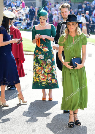 Lady Kitty Spencer, centre, and Victoria Aitken, right, arrive for the wedding ceremony of Prince Harry and Meghan Markle at St. George's Chapel in Windsor Castle in Windsor, near London, England