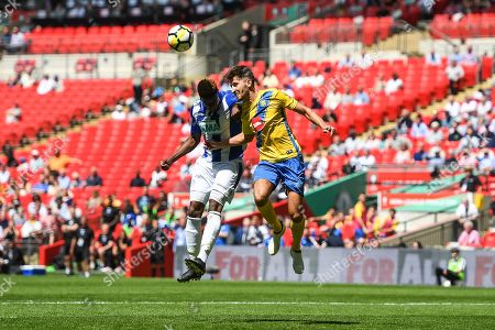 Stock Image of Gavin James of Thatcham Town (10) and Joe Carter of Stockton Town (2) challenge for the header during the FA Vase match between Stockton Town and Thatcham Town at Wembley Stadium, London. Picture by Stephen Wright