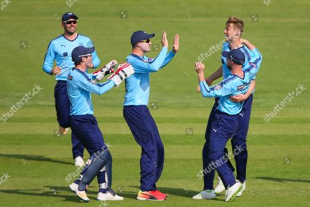 Yorkshire players celebrate the wicket of Warwickshire's Jonathan Trott.