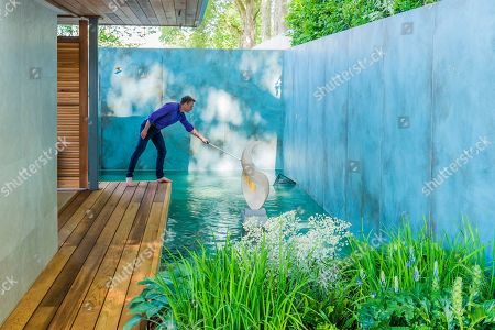 Chris Beardshaw makes final preparations on The Morgan Stanley Garden for the NSPCC, Sponsor: Morgan Stanley, Designer: Chris Beardshaw and Contractor: Structure - GroupThe RHS Chelsea Flower Show at the Royal Hospital, Chelsea.
