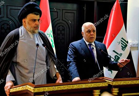 "Haider al-Abadi, Muqtada al-Sadr. In this photo provided by the Iraqi government, Iraqi Prime Minister Haider al-Abadi, right, and Shiite cleric Muqtada al-Sadr hold a press conference in the heavily fortified Green Zone in Baghdad, Iraq, early . Shiite cleric Muqtada al-Sadr, whose coalition won the largest number of seats in Iraq's parliamentary elections, says the next government will be ""inclusive."" The May 12 vote did not produce a single bloc with a majority, raising the prospect of weeks or even months of negotiations to agree on a government"