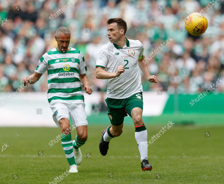 Seamus Coleman of Republic of Ireland chased by Henrik Larsson of Celtic.