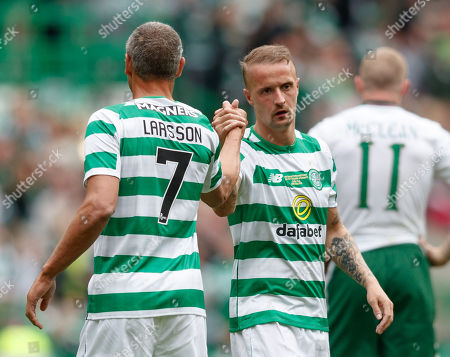 Leigh Griffiths of Celtic shoes hands with Henrik Larsson as he walks off the pitch to be substituted.