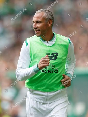 Henrik Larsson of Celtic warms up.