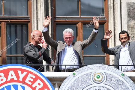 Bayern's head coach Jupp Heynckes (C) and Bayern's director of sport Hasan Salihamidzic (R) celebrate on the balcony of the City Hall at the Marienplatz Square where the team was cheered by thousands supporters, in Munich, Germany, 20 May 2018. FC Bayern Munich is the German Bundesliga Champion for the 2017/18 season.