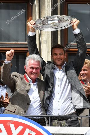Bayern's head coach Jupp Heynckes (L) and Bayern's goalkeeper Manuel Neuer celebrate on the balcony of the City Hall at the Marienplatz Square where the team was cheered by thousands supporters, in Munich, Germany, 20 May 2018. FC Bayern Munich is the German Bundesliga Champion for the 2017/18 season.