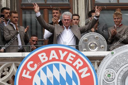 Bayern coach Jupp Heynckes celebrates on the balcony of the town hall at Marienplatz square the 28th Bundesliga title at the German first division Bundesliga in Munich, Germany