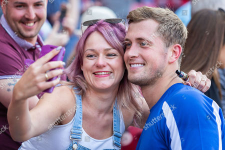 Stock Image of Dan Osbourne takes a selfie with a fan after the final whistle