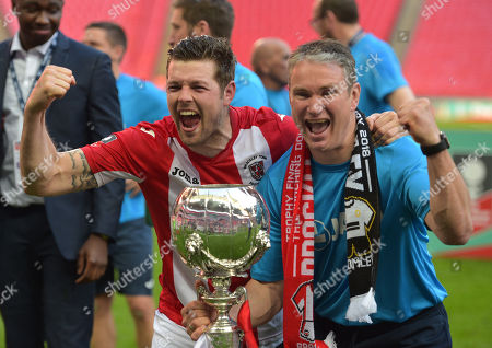 Brackley Town Manager Kevin Wilkin and Andy Brown celebrates at full-time