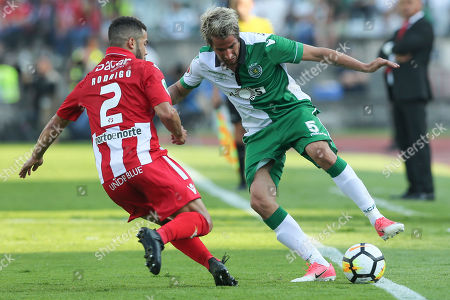 Stock Picture of Desportivo das Aves player Rodrigo Soares (L) fights for the ball with Sporting CP's Fabio Coentrao during the Portugal Cup Final match at Jamor Stadium in Oeiras on the outskirts of Lisbon, Portugal, 20 May 2018.