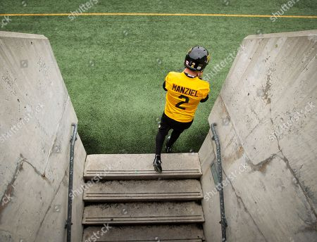 The newest addition to the Canadian Football League Hamilton Tiger-Cats roster, quarterback Johnny Manziel (2) enters the field for the first time at McMaster University during Tiger Cats training camp in Hamilton, Ontario on . Heisman Trophy winner Manziel signed a two-year contract with the Hamilton Tiger-Cats on Saturday, looking to salvage his football career after a turbulent and unsuccessful stay with the Cleveland Browns