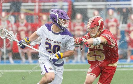 Uniondale, NY, U.S. - Noah Taylor (#20) works against Zach Runberg (#25) as UAlbany Men's Lacrosse defeats Denver 15-13 on  in the NCAA tournament Quarterfinals