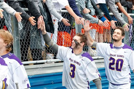 Uniondale, NY, U.S. - TD Ierlan (#3) and Noah Taylor (#20) celebrate with the fans as UAlbany Men's Lacrosse defeats Denver 15-13 on  in the NCAA tournament Quarterfinals