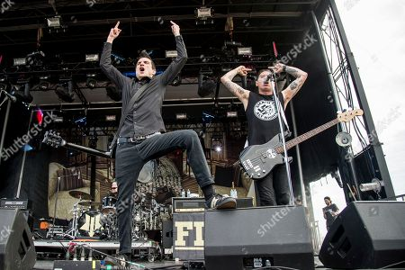 Stock Photo of Justin Sane, Chris Barker. Justin Sane, left, and Chris Barker of Anti-Flag perform at the Rock On The Range Music Festival at Mapfre Stadium, in Columbus, Ohio