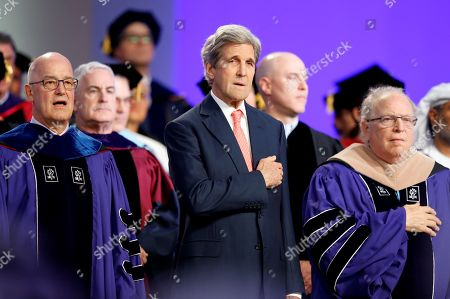 (L-R) NYU President Andrew Hamilton, former US Secretary of State John Kerry and Chair of the NYU Board of Trustees William R. Berkley attend fifth edition of the University's Commencement Exercises of New York University Abu Dhabi (NYUAD) in Abu Dhabi, United Arab Emirates, 20 May 2018. The event also includes a celebration of NYU Abu Dhabi graduating of 253 graduates from over 71 countries make up the Class of 2018, representing the world's leading young talent in the fields of science, arts and humanities, and social science. This graduating class includes two Rhodes Scholars, two Fulbright Scholars, and soon-to-be graduate students in universities such as the University of Oxford, Harvard University, Stanford University, and Duke University.