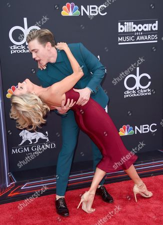 Jesse McCartney, Katie Peterson. Jesse McCartney dips Katie Peterson as they arrive at the Billboard Music Awards at the MGM Grand Garden Arena, in Las Vegas