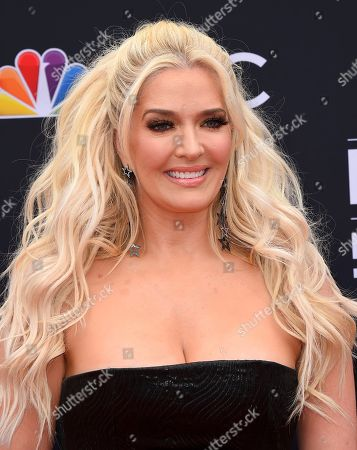 Erika Girardi, Erika Jayne. Erika Jayne arrives at the Billboard Music Awards at the MGM Grand Garden Arena, in Las Vegas