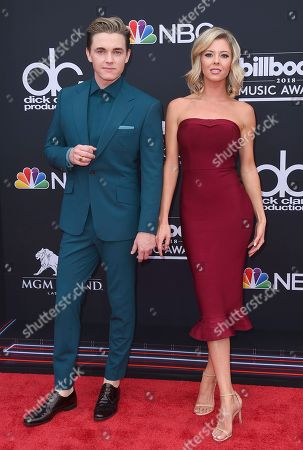 Jesse McCartney, Katie Peterson. Jesse McCartney, left, and and Katie Peterson arrive at the Billboard Music Awards at the MGM Grand Garden Arena, in Las Vegas
