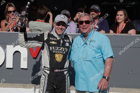 Ed Carpenter, left, celebrates with golfer Fuzzy Zoeller after winning the pole during qualifications for the IndyCar Indianapolis 500 auto race at Indianapolis Motor Speedway in Indianapolis