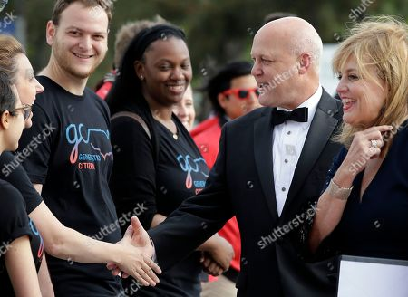 Former New Orleans Mayor Mitch Landrieu, front, greets people as he arrives with his wife Cheryl, right, at the John F. Kennedy Presidential Library and Museum before 2018 Profile in Courage award ceremonies, in Boston. Landrieu is scheduled to be presented with the award during ceremonies Sunday