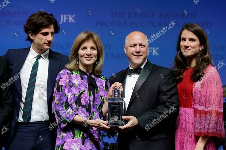 Jack Schlossberg, Caroline Kennedy, Mitch Landrieu, Tatiana Schlossberg. Caroline Kennedy, center left, daughter of President John F. Kennedy, presents former New Orleans Mayor Mitch Landrieu, with the 2018 John F. Kennedy Profile in Courage Award at the John F. Kennedy Presidential Library and Museum, in Boston. Landrieu was presented with the award for his leadership in removing Confederate memorials in his city. Kennedy's son Jack Schlossberg, left, and daughter Tatiana Schlossberg pose for a photo together with them