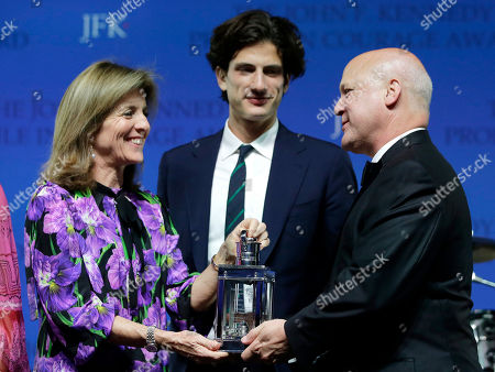 Stock Photo of Caroline Kennedy, Jack Schlossberg, Mitch Landrieu. Caroline Kennedy, left, daughter of President John F. Kennedy, with her son Jack Schlossberg, center, presents former New Orleans Mayor Mitch Landrieu with the 2018 John F. Kennedy Profile in Courage Award at the John F. Kennedy Presidential Library and Museum, in Boston. Landrieu was presented with the award for his leadership in removing Confederate memorials in his city
