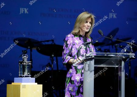 Caroline Kennedy, daughter of President John F. Kennedy, addresses an audience before presenting former New Orleans Mayor Mitch Landrieu with the 2018 John F. Kennedy Profile in Courage Award, left, during ceremonies at the John F. Kennedy Presidential Library and Museum, in Boston. Landrieu was presented with the award for his leadership in removing Confederate memorials in his city