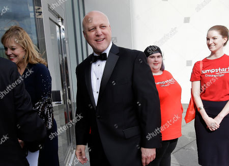 Former New Orleans Mayor Mitch Landrieu, center left, arrives with his wife Cheryl, left, at the John F. Kennedy Presidential Library and Museum before 2018 John F. Kennedy Profile in Courage Award ceremonies, in Boston. Landrieu was presented with the award for his leadership in removing Confederate memorials in his city