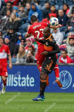 Sunday th- Houston Dynamo defender Adolfo Machado (3) performs a header during MLS game action between the Houston Dynamos and the Chicago Fire at the Toyota Stadium in Bridgeview, IL