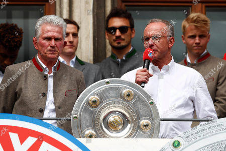 Bayern coach Jupp Heynckes, left, and Bayern Munich CEO Karl-Heinz Rummenigge stand on the balcony of the town hall at Marienplatz square celebrating the 28th Bundesliga title at the German first division Bundesliga in Munich, Germany
