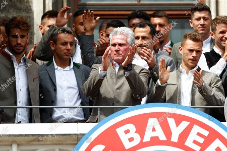 Bayern coach Jupp Heynckes, center, and his team celebrate on the balcony of the town hall at Marienplatz square the 28th Bundesliga title at the German first division Bundesliga in Munich, Germany