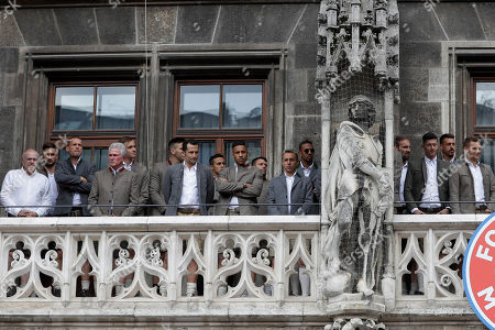 Bayern coach Jupp Heynckes, 4th left, and his players stand on the balcony of the town hall at Marienplatz square celebrating the 28th Bundesliga title at the German first division Bundesliga in Munich, Germany