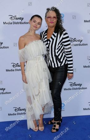 Eline Powell, Rena Owen. Eline Powell, left, and Rena Owen arrive at the Disney's International Upfront Red Carpet at Disney Studios, in Burbank, Calif