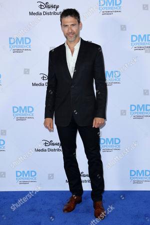 Adam Rayner arrives at the Disney's International Upfront Red Carpet at Disney Studios, in Burbank, Calif