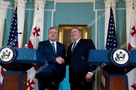 Secretary of State Mike Pompeo shakes hands with Georgian Prime Minister Giorgi Kvirikashvili during a news conference before their bilateral meeting at State Department, in Washington